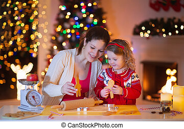 Mother and daughter baking gingerbread for Christmas dinner...