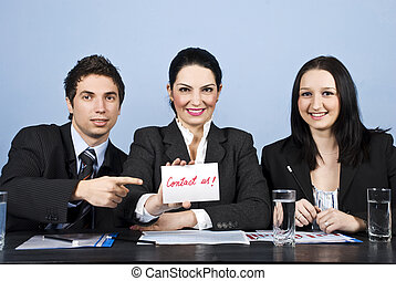 Business people team with contact us message - Group of...
