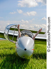 Fun in glider plane, hands up in the air
