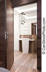 Entrance to contemporary bathroom - Image of entrance to...