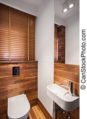 Wood bathroom with white fixture - Photo of wood stylish...