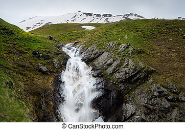 Waterfall in the Caucasus Mountains, Georgia - Cloudy day in...
