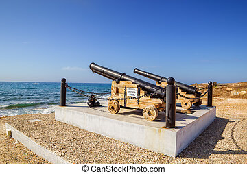 Old cannon ball guns monument by the Paphos castle on the...