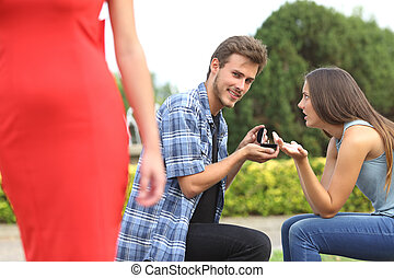 Unfaithful man looking another girl during proposal - Amazed...