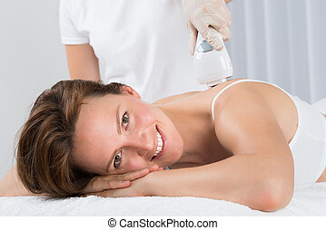 Woman Getting Epilation Laser Treatment - Young Beautiful...