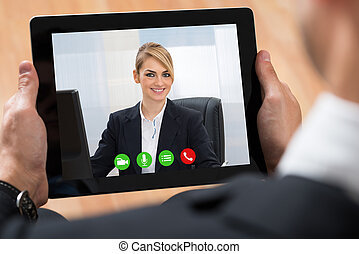 Businessperson Videochatting On Digital Tablet - Close-up Of...