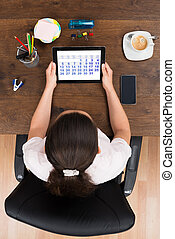 Businesswoman Looking At Calendar On Digital Tablet