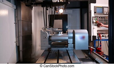View of factory worker starts milling machine at workshop