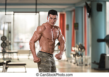 Portrait Of A Physically Fit Young Man In Modern Fitness...