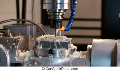 View close-up on running milling machine in production shop