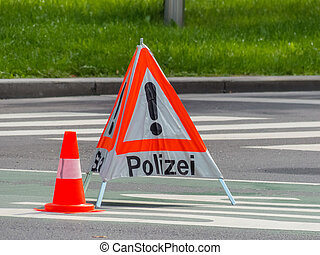 police operation roadblock - a road is blocked in a police...