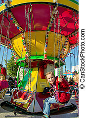 child on kirtag in kettenkarusell, carousel, ka - child...