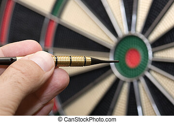 dartboard - a player throwing a dart at a party