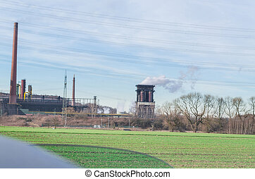 Old power plant on greenfield - Old power plant on a...