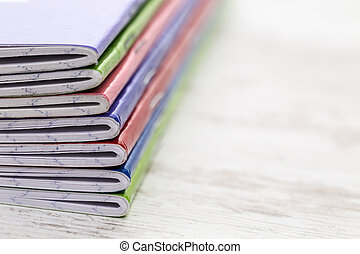 Stack of Notebooks - Close-up image of a stack of colorful...