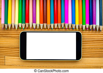Smart phone with pencils on the table