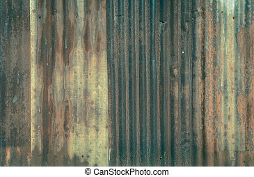 Rusty corrugated metal wall background in retro filter...