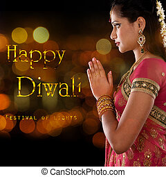 Happy Diwali, festival of lights - Indian woman in...