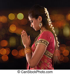 Indian female prayer - Indian woman in traditional sari...