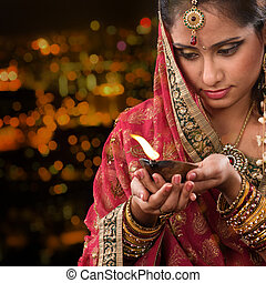 Indian girl hands holding diwali oil lamp - Indian female in...