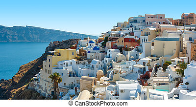 Colorful houses on the hill in Oia, Santorini