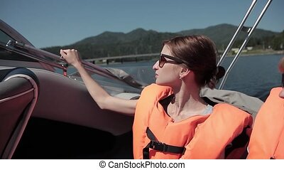 Beautiful woman wearing in orange life jacket