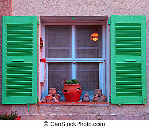 French rustic window with green wood shutters