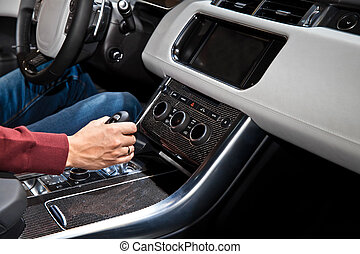 Hand holding automatic transmission in car - Driver man hand...