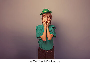 European appearance teenager boy in T-shirt with green hat
