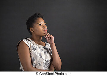 African American woman with hand on chin thinking - South...