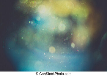 Glittering Bokeh - Defocused dust particles against sun,...