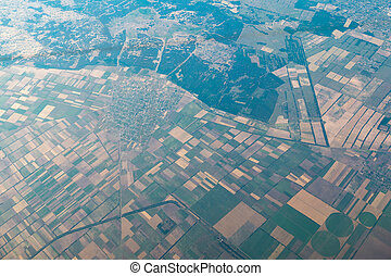 air view on landscape with geometric shaped vegetable...