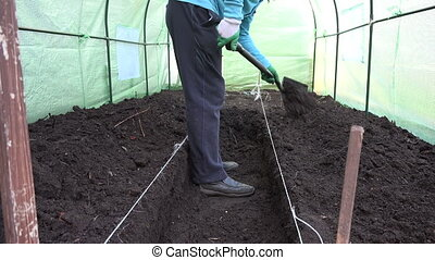 man work hothouse - farmer prepare greenhouse for summer...
