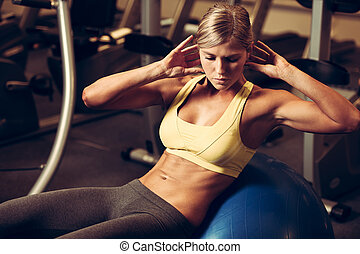 beautiful athletic woman working ab intervals in fitness -...