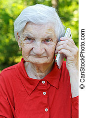 Talking on the phone - Relaxed elderly woman listening a...