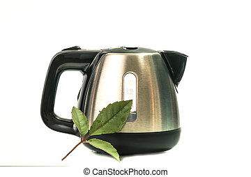 stainless electric kettle isolated on white background with green leaf