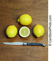 Lemons on a table with a knife