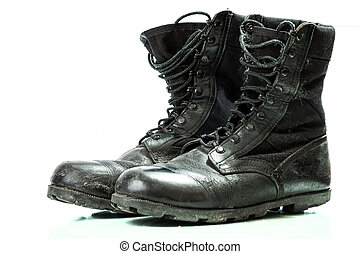 Black old combat military boots isolated on white background