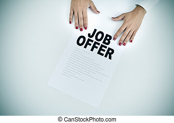 businesswoman shows a document with the text job offer