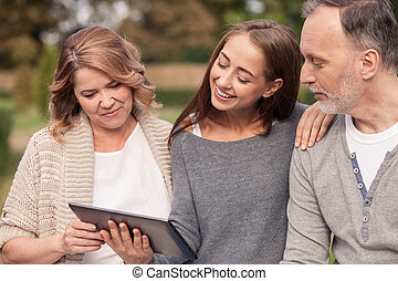 Cute mature family are watching a laptop - Pretty old...