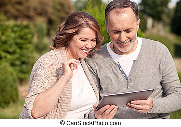 Pretty mature family is using a laptop for fun - Cute old...