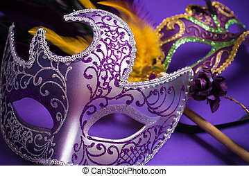 Mardi Gras or carnival mask on purple background - Mardi...