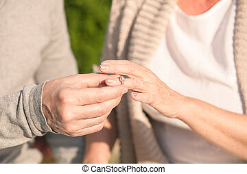 Pretty old married couple is celebrating their anniversary -...