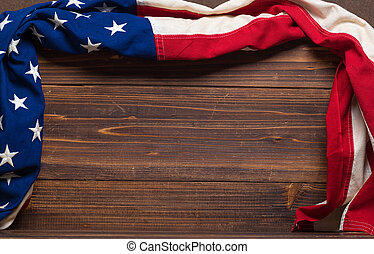 Old American Flag on wooden plank background