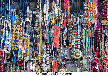 Garlands of tantric beads of different colors