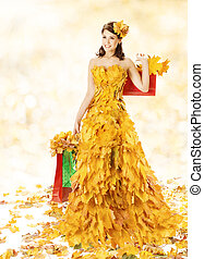 Shopping Woman In Autumn Fashion Dress Of Yellow Fall Leaves Bags
