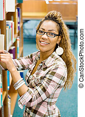 librarian - an african american librarian putting books away