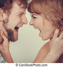 Angry woman and man yelling at each other. - relationship...
