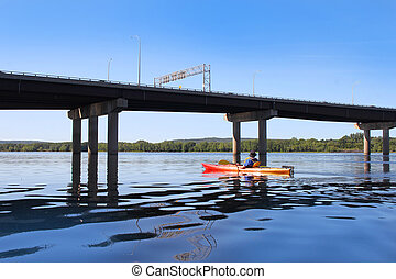 Kayaking on the river in Fredericton - Man kayaking on the...