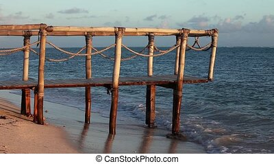 Wood bridge on the beach